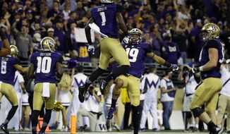 Washington wide receiver John Ross (1) celebrates with wide receiver Andre Baccellia (19) after Ross caught a pass for a touchdown against Stanford in the first half of an NCAA college football game, Friday, Sept. 30, 2016, in Seattle. (AP Photo/Ted S. Warren)