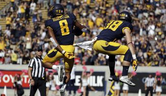California's Demetris Robertson, left, celebrates, celebrates his 39-yard touchdown catch with teammate Patrick Worstell against Utah during the first half of an NCAA college football game Saturday, Oct. 1, 2016, in Berkeley, Calif. (AP Photo/Marcio Jose Sanchez)