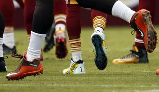 Washington Redskins wide receiver DeSean Jackson (11) wears police caution tape themed cleats during the first half of an NFL football game against the Cleveland Browns, Sunday, Oct. 2, 2016, in Landover, Md. (AP Photo/Carolyn Kaster)