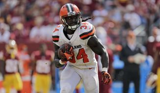 Cleveland Browns running back Isaiah Crowell (34) runs with the ball during the second half of an NFL football game against the Washington Redskins, Sunday, Oct. 2, 2016, in Landover, Md. (AP Photo/Mark Tenally)
