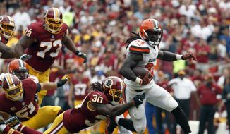 Washington Redskins strong safety David Bruton (30) tackles Cleveland Browns running back Isaiah Crowell (34) during the first half of an NFL football game Sunday, Oct. 2, 2016, in Landover, Md. (AP Photo/Carolyn Kaster)
