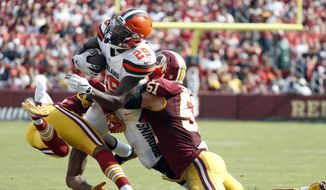 Cleveland Browns running back Duke Johnson (29) is hit by cornerback Josh Norman, left, and Washington Redskins inside linebacker Will Compton (51) during the second half of an NFL football game, Sunday, Oct. 2, 2016, in Landover, Md. (AP Photo/Carolyn Kaster)