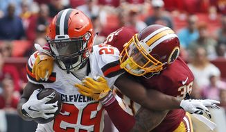 Cleveland Browns running back Duke Johnson (29) is tackled by Washington Redskins defensive back Su'a Cravens (36) during the first half of an NFL football game, Sunday, Oct. 2, 2016, in Landover, Md. (AP Photo/Carolyn Kaster)