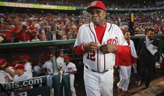 Washington Nationals manager Dusty Baker walks out of the dugout after the final out of a baseball game against the Miami Marlins at Nationals Park, Sunday, Oct. 2, 2016 in Washington. Nationals won 10-7. The NL East Champion Nationals, who will face Los Angeles in the division series, finished the regular season 95-67, a 12-game improvement in Baker's first season as manager. (AP Photo/Pablo Martinez Monsivais)