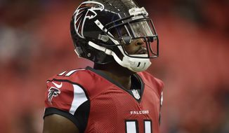 Atlanta Falcons wide receiver Julio Jones (11) warms up before the first half of an NFL football game between the Atlanta Falcons and the Carolina Panthers, Sunday, Oct. 2, 2016, in Atlanta. (AP Photo/Rainier Ehrhardt)