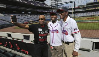 Security guard D.J. Johnson, left) and ushers Damion Carpenter and Walter Banks snap a selfie while working the final Braves game at Turner Field on Sunday, Oct. 2, 2016, in Atlanta. The team will move to their new stadium in Cobb County for the 2017 season.   (Curtis Compton/Atlanta Journal-Constitution via AP)