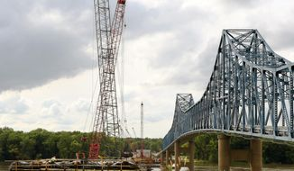 """In this Sept. 13, 2016 photo, several of the piers for the new U.S. 52/IL 64 bridge project are complete over the Mississippi River from Sabula, Iowa to Savanna, Illinois. The current bridge, built in 1932 over the Mississippi River, is """"in need of a full replacement according to the Illinois Department of Transportation. At 20 feet wide, it is too narrow to meet current safety standards, and does not accommodate disabled vehicles or bicycle traffic. (Kevin Schmidt Newsroom   /Quad City Times via AP)"""