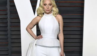"""FILE - In this Feb. 28, 2016 file photo, Lady Gaga arrives at the Vanity Fair Oscar Party in Beverly Hills, Calif. Lady Gaga is choosing the intimacy of dive bars over arenas to showcase songs from her new album, """"Joanne."""" She'll appear at a handful of bars beginning this week as a nod to the album's """"raw Americana"""" vibe and where she got her start, Gaga and tour partner Bud Light announced Sunday, Oct. 2, 2016. (Photo by Evan Agostini/Invision/AP, File)"""