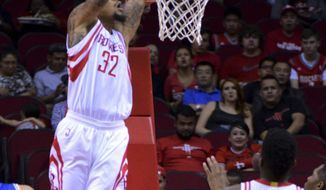 The Houston Rockets K.J. McDaniels puts in a shot against the Shanghai Sharks in the first half of an NBA basketball exhibition game Sunday, Oct. 2, 2016, in Houston. (AP Photo/George Bridges)