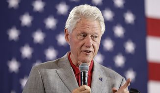 """You've got this crazy system where all of a sudden 25 million more people have health care and then the people are out there busting it, sometimes 60 hours a week, wind up with their premiums doubled and their coverage cut in half,"" Bill Clinton said. ""It's the craziest thing in the world."" (Associated Press)"