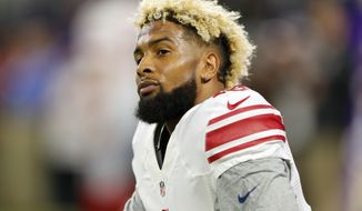 New York Giants wide receiver Odell Beckham stretches before an NFL football game against the Minnesota Vikings Monday, Oct. 3, 2016, in Minneapolis. (AP Photo/Jim Mone)