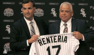 Chicago White Sox senior vice president and general manager Rick Hahn, left, poses with Rick Renteria after Hahn announced that Renteria will replace Robin Ventura as manager of the ball club during a baseball news conference Monday, Oct. 3, 2016, in Chicago. (AP Photo/Charles Rex Arbogast)