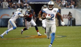 Detroit Lions' Andre Roberts (12) runs to the end zone for a touchdown on a punt return during the second half of an NFL football game against the Chicago Bears, Sunday, Oct. 2, 2016, in Chicago. (AP Photo/Nam Y. Huh)