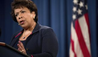 File- This Sept. 22, 2016, file photo shows Attorney General Loretta Lynch responding to a question during a news conference at the Justice Department in Washington.  Lynch is announcing Justice Department grants Monday, Oct. 3, 2016, to help police departments across the country hire new officers. The $119 million in funding is being announced in Dallas, site of a sniper ambush in July that left five officers dead, at the start of National Community Policing Week. (AP Photo/Andrew Harnik, File)
