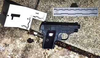 This evidence photo on display at a news conference on Monday, Oct. 3, 2016, at Los Angeles Police headquarters shows a fake gun that was found after the fatal shooting of a hispanic man on Sunday, Oct. 2, 2016. The police chief disclosed details of Saturday's shooting of Carnell Snell, in South Los Angeles and a separate fatal police shooting of a Hispanic man Sunday amid heightened tensions over police shootings involving blacks and other minorities in California and elsewhere. (AP Photo/Nick Ut)