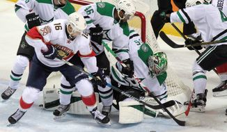 Florida Panthers' Aleksander Barkov (16) tries to control the puck in front of Dallas Stars goalie Maxime Lagace (35) as Stars' Ludwig Bystrom (36) and Gemel Smith defend during NHL hockey preseason action in London, Ontario, Sunday, Oct. 2, 2016. (Dave Chidley/The Canadian Press via AP)