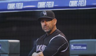 FILE - In this Sept. 30, 2016, file photo, Colorado Rockies manager Walt Weiss watches during the first inning of the team's baseball game against the Milwaukee Brewers, in Denver. Weiss is out as manager of the Colorado Rockies after four seasons in charge. In a statement Monday, Oct. 3, 2016, the team said Weiss has decided to step down. (AP Photo/David Zalubowski, File)