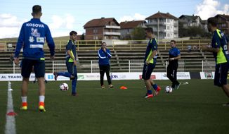 Kosovo's national team head coach Albert Bunjaki 3rd from left, attends a training session ahead of the World Cup Group I qualifying soccer match between Kosovo and Croatia at Feronikeli stadium in Drenas, Kosovo on Monday, Oct. 3, 2016. Kosovo was fast-tracked into the World Cup qualifiers after became a UEFA and FIFA member last May. Thursday's match against Croatia will be played in Albania's northern city of Shkodra as Kosovo has no stadium certified by UEFA. Three days later Kosovo travels to Ukraine. (AP Photo/Visar Kryeziu)