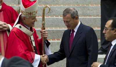 Cardinal Donald Wuerl, Archbishop of Washington, shake hands with U.S. Supreme Court Chief Justice John Roberts as they leave St. Mathews Cathedral after the Red Mass in Washington on Sunday, Oct. 2, 2016. The Supreme Court's new term starts Monday, Oct. 3. (AP Photo/Jose Luis Magana)