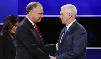 Republican vice-presidential nominee Gov. Mike Pence, right, and Democratic vice-presidential nominee Sen. Tim Kaine shake hands during the vice-presidential debate at Longwood University in Farmville, Va., Tuesday, Oct. 4, 2016. (AP Photo/David Goldman)