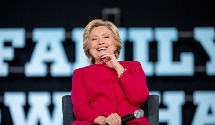 Democratic presidential candidate Hillary Clinton smiles while on stage at a town hall at the Haverford Community Recreation and Environmental Center in Haverford, Pa., Tuesday, Oct. 4, 2016. (AP Photo/Andrew Harnik)