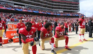 San Francisco 49ers Eli Harold (58), Eric Reid (35) and Colin Kaepernick (7) take a knee during the National Anthem prior to action against the Dallas Cowboys during an NFL football game Saturday, Oct. 2, 2016, in Santa Clara, CA. The Cowboys won 24-17. (Daniel Gluskoter/AP Images for Panini)