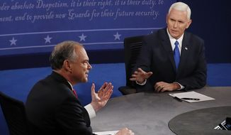 Mike Pence (right) speaks as Tim Kaine listens during the vice-presidential debate on Tuesday at Longwood University in Farmville, Virginia. (Associated Press)