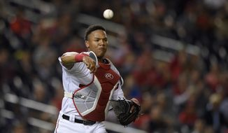 Washington Nationals catcher Pedro Severino throws to first during a baseball game against the Arizona Diamondbacks, Tuesday, Sept. 27, 2016, in Washington. The Nationals won 4-2. (AP Photo/Nick Wass)
