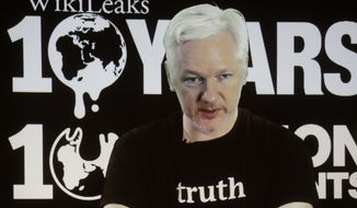 WikiLeaks founder Julian Assange participates via video link at a news conference marking the 10th anniversary of the secrecy-spilling group in Berlin, Germany, Tuesday, Oct. 4, 2016. (AP Photo/Markus Schreiber) ** FILE **