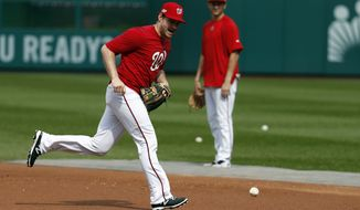 Washington Nationals second baseman Daniel Murphy runs after a ground ball during baseball batting practice at Nationals Park, Tuesday, Oct. 4, 2016, in Washington. The Nationals host the Los Angeles Dodgers in Game 1 of the National League Division Series on Friday. AP Photo/Alex Brandon)