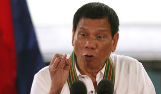 Philippine President Rodrigo Duterte addresses army troopers during his visit to its headquarters in suburban Taguig city east of Manila, Philippines Tuesday Oct. 4, 2016. U.S. and Philippine forces opened their first large scale combat exercises under President Duterte in uncertainty Tuesday after he said the drills will be the last in his six-year presidency partly to avoid upsetting China.(AP Photo/Bullit Marquez)