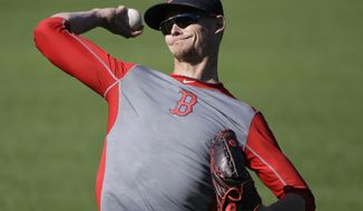 Boston Red Sox pitcher Clay Buchholz throws during a baseball team workout at Fenway Park, Tuesday, Oct. 4, 2016, in Boston, as they prepare for Game 1 of the  American League Division Series scheduled for Thursday in Cleveland. (AP Photo/Elise Amendola)