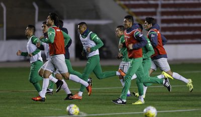 Bolivia's soccer players warm up during a practice session in La Paz, Bolivia, Monday, Oct. 3, 2016. Bolivia will face Brazil in a 2018 World Cup qualifying soccer match in Natal, on Thursday. (AP Photo/Juan Karita)