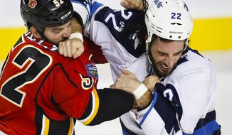Winnipeg Jets' Chris Thorburn, right, and Calgary Flames' Brandon Bollig fight during the second period of a pre-season NHL hockey game in Calgary, Sunday, Oct. 2, 2016. (Jeff McIntosh/The Canadian Press via AP)