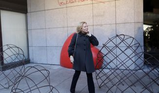 Widow of late Czech Republic's President Vaclav Havel, Dagmar Havlova poses for a photo by a memorial that was unveiled on the eve of 80th anniversary of his birth in Prague, Czech Republic, Tuesday, Oct. 4, 2016. (AP Photo/Petr David Josek)