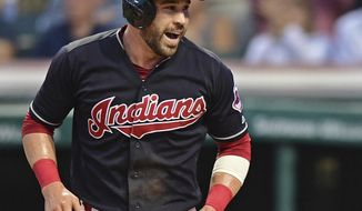 FILE - In this Sept. 16, 2016, file photo, Cleveland Indians' Jason Kipnis celebrates after scoring in the first inning of a baseball game against the Detroit Tigers, in Cleveland.  While most of America gushes over the Chicago Cubs and their quest at ending a 108-year World Series drought, Cleveland's taking aim at its own championship dryspell following a season in which the Indians overcame numerous obstacles and outclassed the AL Central. (AP Photo/David Dermer, File)
