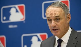 FILE - In this May 19, 2016, file photo, Baseball Commissioner Rob Manfred speaks to reporters during a news conference at Major League Baseball headquarters in New York. Manfred supports changing the rule that expands active rosters from 25 to 40 each Sept. 1. (AP Photo/Mary Altaffer, File)