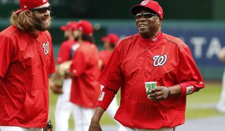 Washington Nationals left fielder Jayson Werth, left, and manager Dusty Baker share a laugh during baseball batting practice at Nationals Park, Tuesday, Oct. 4, 2016, in Washington. The Nationals host the Los Angeles Dodgers in Game 1 of the National League Division Series on Friday. AP Photo/Alex Brandon)