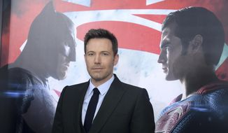 """FILE - In this March, 20 2016, file photo, Ben Affleck attends the premiere of """"Batman v Superman: Dawn of Justice"""" at Radio City Music Hall in New York. Affleck told Washington's WTTG-TV in an interview published on YouTube Oct. 2, 2016, that he loved """"Batman v. Superman"""" and took issue with critics who disliked the film's dark tone. (Photo by Charles Sykes/Invision/AP, File)"""