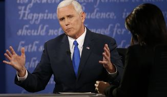 Republican vice-presidential nominee Gov. Mike Pence (left) speaks with moderator Elaine Quijano (right) of CBS News as Democratic vice-presidential nominee Sen. Tim Kaine (not seen) listens during the vice presidential debate at Longwood University in Farmville, Va., on Oct. 4, 2016. (Associated Press) **FILE**