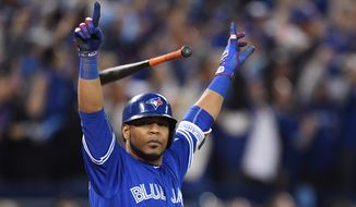Toronto Blue Jays' Edwin Encarnacion celebrates after hitting a walk-off three-run home run against the Baltimore Orioles during the 11th inning of an American League wild-card game Tuesday in Toronto. (The Canadian Press via Associated Press)