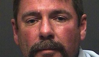 FILE - This April 26, 2015 file photo provided by the Pima County Sheriff's Department shows, David Dwayne Watson, in Tucson, Ariz. The criminal case against the former Tucson Fire Department Capt., Watson, who built his career while he was a murder suspect in the cold case killings of his ex-wife, her mother and her mother's friend, begins with opening statements in Tucson on Wednesday, Oct. 5, 2016.  (Pima County Sheriff's Department via AP, File)