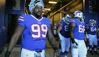 FILE - In this Nov. 8, 2015, file photo, Buffalo Bills defensive tackle Marcell Dareus (99) heads to the field before playing the Miami Dolphins in an NFL football game, in Orchard Park, N.Y.  Bills star defensive tackle Marcell Dareus returns to practice on Wednesday, Oct. 5, 2016, after serving a four-game suspension for violating the  NFL's substance abuse policy.  (AP Photo/Bill Wippert, File)