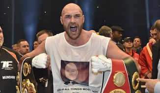 FILE - In this Nov. 29, 2015 file photo, Britain's new world champion Tyson Fury, celebrates with the WBA, IBF, WBO and IBO belts after winning the world heavyweight title fight against Ukraine's Wladimir Klitschko in Duesseldorf, western Germany. Tyson Fury's boxing career could be over after the reigning IBF, WBO and WBA heavyweight champion announced his retirement in a profanity-filled tweet on Monday Oct. 3, 2016. (AP Photo/Martin Meissner, File) **FILE**