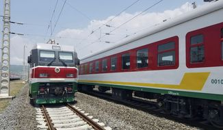 In this photo of Saturday, Sept.24, 2016, locomotives for the new Ethiopia to Djibouti electric railway system queue outside a train station in the outskirts of Addis Ababa. One of Africa's best-performing economies on Wednesday launched its latest massive infrastructure project, a railway linking the landlocked country with a major port on the Gulf of Aden. But it came just days after dozens were killed in anti-government protests in the region the railway runs through. (AP Photo/Elias Meseret)