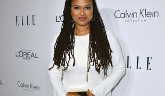 """FILE - In this Oct. 19, 2015 file photo, director Ava DuVernay attends the 2015 ELLE Women in Hollywood Awards in Los Angeles. Duvernay's latest project, """"The 13th,"""" is a documentary about mass incarceration and its deep, historical roots in America. (Photo by Jordan Strauss/Invision/AP, File)"""