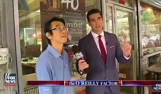 """Fox News personality Jesse Watters is being called a racist for a man-on-the-street segment on """"The O'Reilly Factor,"""" in which he asked several Asian people in New York City's Chinatown about their political views. (Fox News)"""