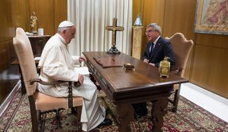 Pope Francis meets Thomas Bach, President of the International Olympic Committee, ahead of a international conference on faith and sport, at the Vatican, Wednesday, Oct. 5, 2016. (L'Osservatore Romano/Pool Photo via AP)
