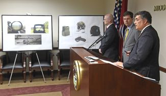 U.S. Attorney for the Middle District of Tennessee David Rivera announces charges against six soldiers from Fort Campbell, Ky., with conspiring to steal sensitive Army equipment including sniper telescopes and rifle accessories, machine gun parts, grenade launcher sights, flight helmets and night vision helmet mounts, during a news conference on Thursday, Oct. 6, 2016. Rivera announced Thursday that more than $1 million in restricted equipment was ultimately sold and shipped, mostly to anonymous eBay bidders, including some in Russia, China, and other foreign nations.   (Larry McCormack/The Tennessean via AP)