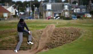 Spain's Alvaro Quiros plays his second shot out of the bunker on the 16th hole, during day one of the Dunhill Links Championship, at Carnoustie Golf Links, in Scotland, Thursday Oct. 6, 2016. (Jane Barlow/PA via AP)
